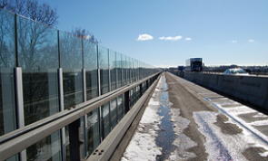 Acrylic sound barriers are seen lining a busy motorway in Denmark